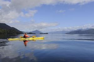 Sea Kayaker in Canal Jacaf, Chonos Archipelago, Aysen, Chile by Fredrik Norrsell