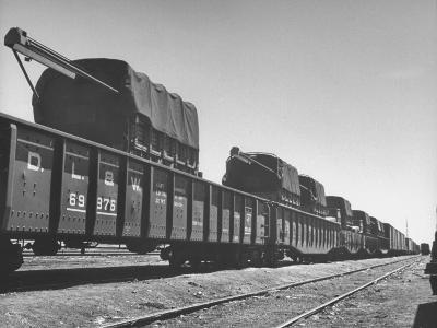 Freight Trains Transporting Trucks and Cables Westbound--Photographic Print