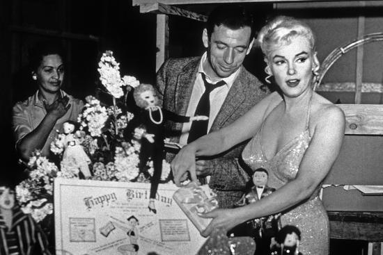 French Actor Yves Montand, American Actress Marilyn Monroe and a ...