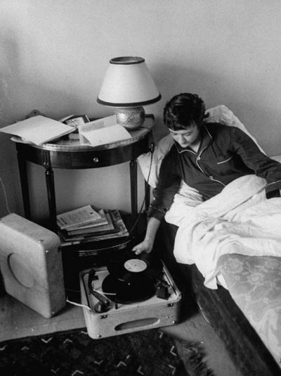 French Authoress Francoise Sagan, Laying in Bed Listening to Music--Premium Photographic Print