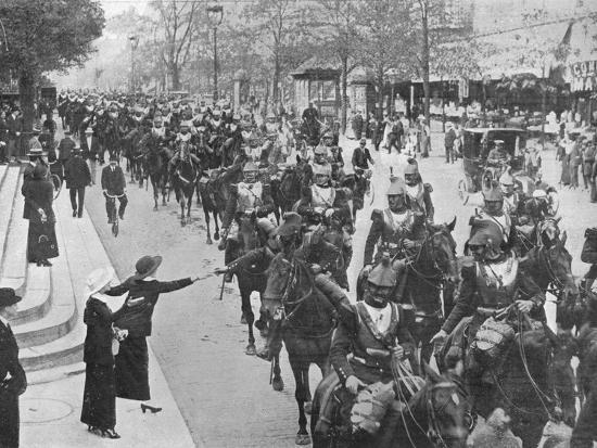 'French cuirassiers riding through the streets of Paris on their way on the front', 1914-Unknown-Photographic Print