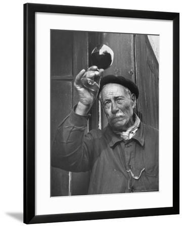 French Man Looking at How Clear the Wine Is-Thomas D^ Mcavoy-Framed Photographic Print