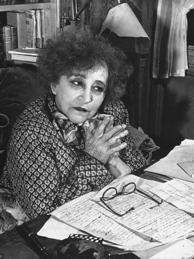 French Novelist Colette, at Desk Covered with Handwritten Notes Topped by Reading Glasses at Home-David Scherman-Premium Photographic Print