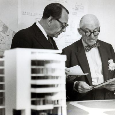 Charles Edouard Jeanneret, known as Le Corbusier (1887-1965) Discussing Architectural Plans, c.1949 by French Photographer