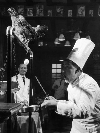 French Restaurant Owner Sam Letrone Entertaining Patrons with His Performing Chicken-Loomis Dean-Photographic Print