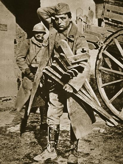 French soldier with wooden crosses to be placed on temporary graves, World War I, c1914-c1918-Unknown-Photographic Print