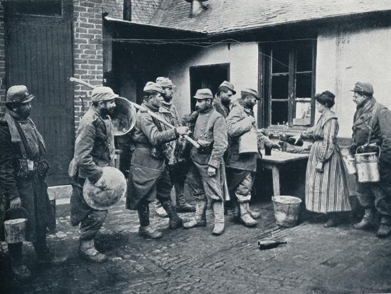 French soldiers returning from the trenches make a halt for refreshment, c1914-Unknown-Photographic Print
