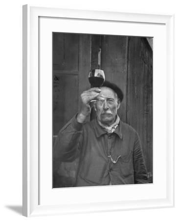 French Vintner Showing the Proper Wine Tasting Technique-Thomas D^ Mcavoy-Framed Photographic Print