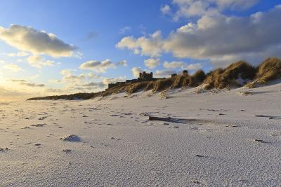 Fresh Spring Snow at Dawn Highlight Ripples and Marks in the Sand Beneath Bamburgh Castle-Eleanor-Photographic Print