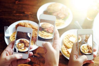 Friends Using Smartphones to Take Photos of Food with Instagram Style Filter-evren_photos-Photographic Print