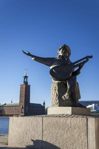 Evert Dove Sculpture with Stockholm City Hall in the Background by Frina
