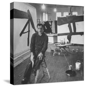 Abstract Expressionist Painter Franz Kline Perching on Stool in His Studio by Fritz Goro