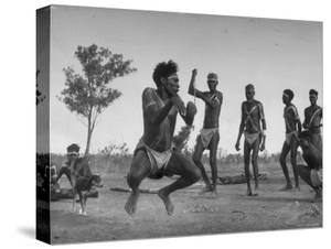 Australian Aborigines Filled with the Spirit of the Kangaroo, Dancing to Honor the Sacred Marsupial by Fritz Goro