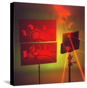 Hologram made by Juris Upatnieks projects on screens when lasers passes through different places by Fritz Goro