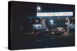 Nighttime View of the Cars at the Entrance to the Detroit-Windsor Tunnel, Detroit, Michigan, 1959 by Fritz Goro