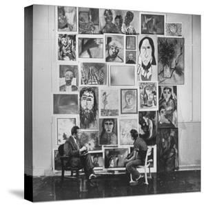 Psychiatrist with Emotionally Disturbed Student in Front of Paintings by others at Special School by Fritz Goro