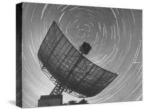 Radio Telescope Listening to Sound from Space as Visible Stars Circle Sky Forming Streaks of Light by Fritz Goro