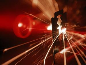 Red Laser Light Focused Through Lens Blasts Pin Point Hole Through Razor in Thousandth of a Second by Fritz Goro
