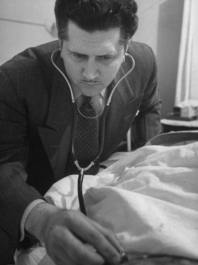 From a Patient's Eye View, Dr. Charles Norton Checking His Heartbeat--Photographic Print