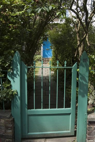 Front Gates with a Path Leading to a Blue Door, of a Residential House-Natalie Tepper-Photo