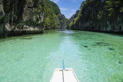 Front of an Outrigger Boat in the Clear Water in the Bacuit Archipelago, Palawan, Philippines-Michael Runkel-Photographic Print