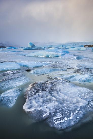 Frozen Icebergs in the Frozen Waters of Fjallsarlon Glacier Lagoon, South East Iceland, Iceland-Neale Clark-Photographic Print