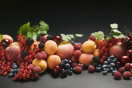 Fruit Still Life with Stone Fruit, Berries and Leaves-Foodcollection-Photographic Print