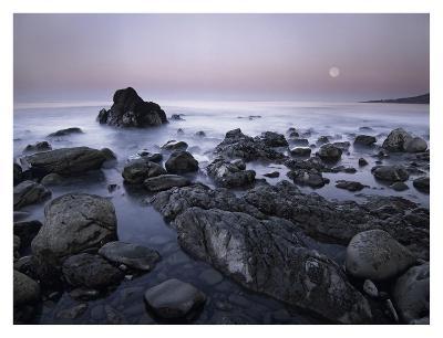 Full moon over boulders at El Pescador State Beach, Malibu, California-Tim Fitzharris-Art Print
