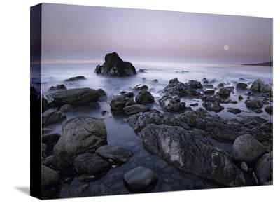 Full moon over boulders at El Pescador State Beach, Malibu, California-Tim Fitzharris-Stretched Canvas Print