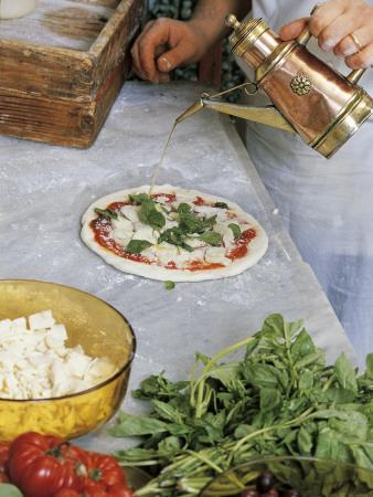 High Angle View of a Chef Making Pizza
