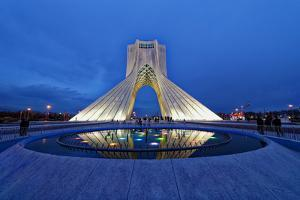 Azadi Tower (Freedom Monument) and cultural complex reflecting in a pond at sunset, Tehran, Iran by G&M Therin-Weise
