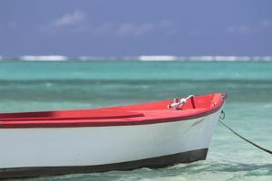 An Empty Boat Moored in the Indian Ocean by Gabby Salazar