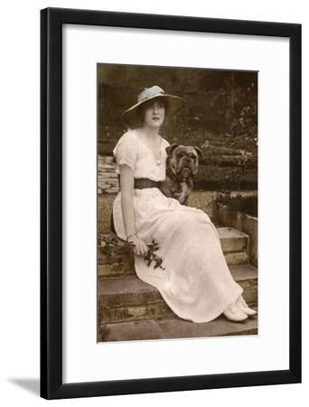 Gabrielle Ray, English Actress, with a Dog in a Garden