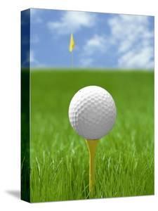 Golf ball on tee by Gaetano