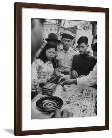 Game of Roulette at Fair in Central Highlands Celebrating New Year's Holiday-John Dominis-Framed Photographic Print