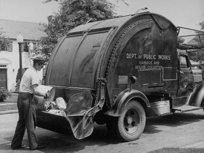Garbage Man Emptying Trash into Back of Garbage Truck-Alfred Eisenstaedt-Photographic Print