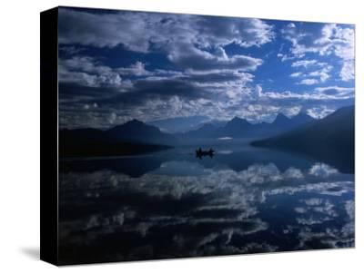 Early Morning Boating in Reflected Sea of Clouds, Lake Mcdonald, Glacier National Park, Montana