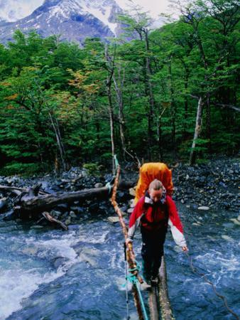 Hiker Crossing Rio Brian on Paine Circuit Trekking Route