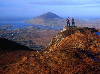 People on Slopes of Diamond Hill in Connemara National Park, Connemara, Ireland