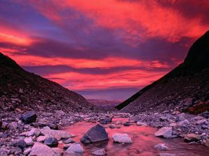 Sunset Reflected in the Waters of the Rio Blanco by Gareth McCormack