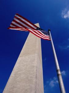 Washington Monument with the National Flag, Washington DC, USA by Gareth McCormack
