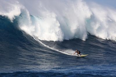Garrett Mcnamara, Big Wave Surfer, Surfing Down a Wave Face at Jaws-Patrick McFeeley-Photographic Print