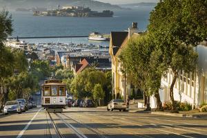 San Francisco City Tram Climbs Up Hyde Street with Alcatraz Beyond, San Francisco, California by Garry Ridsdale