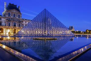 The Louvre Pyramid and Palace Reflected in a Still Pool Within the Napoleon Courtyard at Twilight by Garry Ridsdale