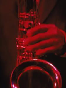 Close-up of Man Playing Saxophone in Jazz Club by Gary Conner