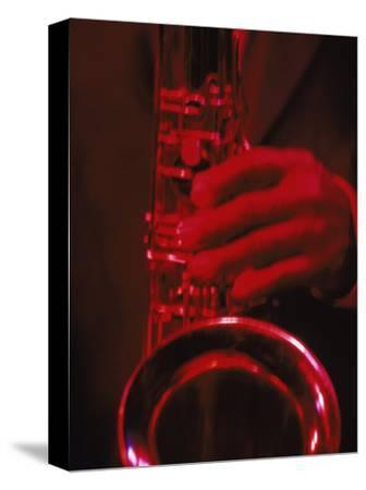 Close-up of Man Playing Saxophone in Jazz Club