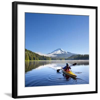 A Woman in a Sea Kayak Paddles on Trillium Lake, Oregon, USA by Gary Luhm