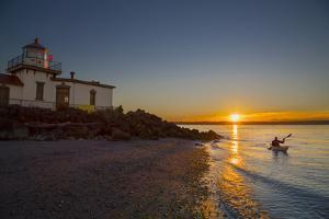 USA, Washington, Seattle. Kayaker Near Discovery Park Lighthouse by Gary Luhm
