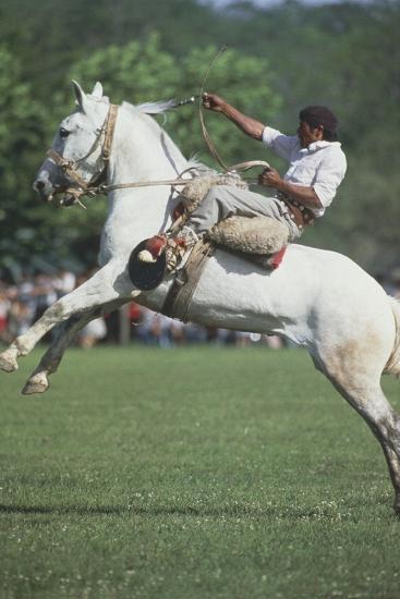 Gaucho Riding on Horseback in Argentina--Photographic Print