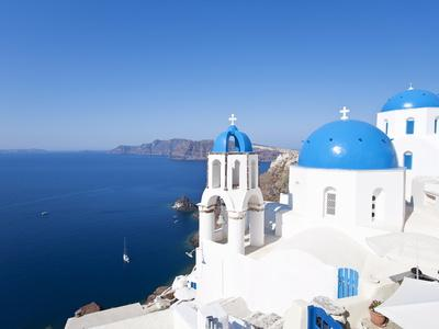 Blue Domed Churches in the Village of Oia, Santorini (Thira), Cyclades Islands, Aegean Sea, Greece